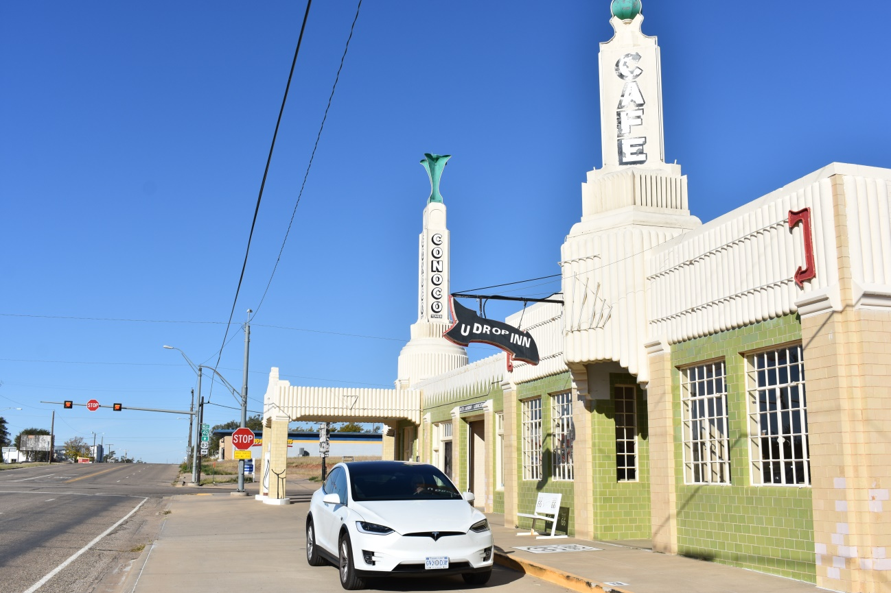 Ellie parked in front of the Conoco Tower Gas Station and the U Drop Inn Café in Shamrock Texas