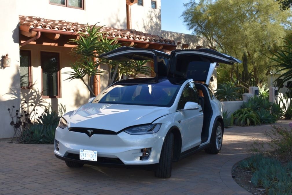 "eLectra (we call her Ellie), our Model X Raven at home in Vista loading up for our ""impossible"" road trip"